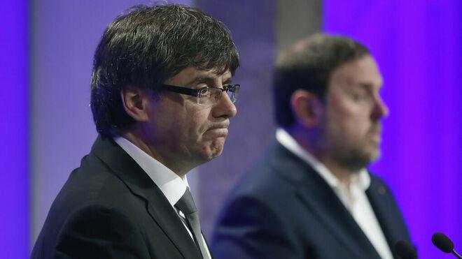 Carles Puigdemont, junto a Oriol Junqueras.