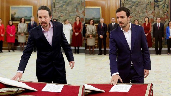 Iglesias y Garzón prometen su cargo con un pin del triángulo rojo invertido, que simboliza la lucha antifascista