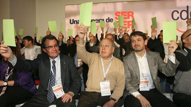 Artur Mas, Jordi Pujol, y Oriol Pujol, en 2012, en un congreso de Convergencia.