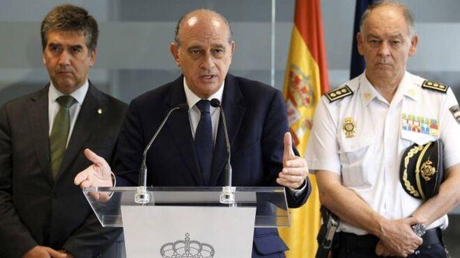 Ignacio Cosidó, el ministro Fernández Díaz y el comisario Pino, la cúpula que marcó una época en la Policía