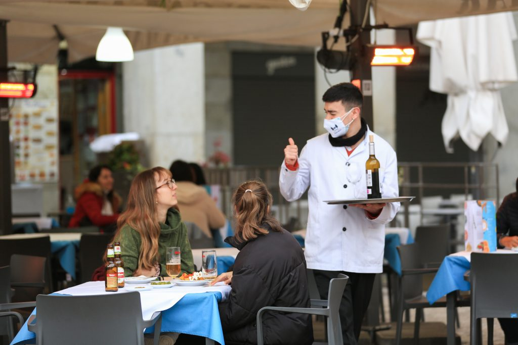 A waiter serves two clients on the terrace of a bar in the center of Madrid (Spain).  Europa Press.