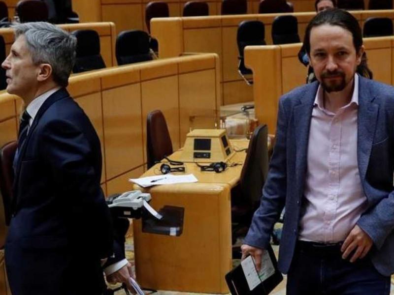 Fernando Grande-Marlaska y Pablo Iglesias-