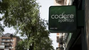 Cartel de Codere en uno de sus locales en Madrid.
