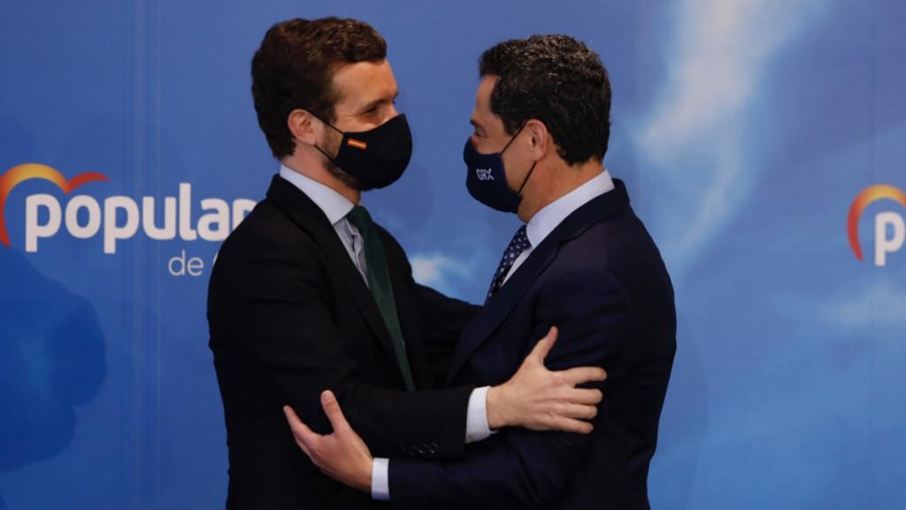 El presidente del PP, Pablo Casado, y el líder del partido en Andalucía, Juanma Moreno.
